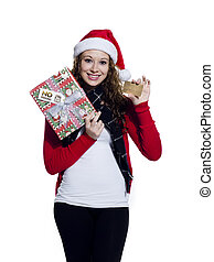 Portrait of a young female with a placard and her Christmas present standing over white background, Model: Brittany Beaudoin