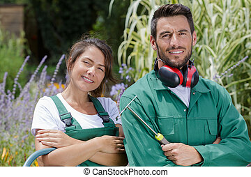 portrait of a young gardening couple