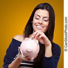 Portrait Of A Young Girl Holding A Piggy Bank