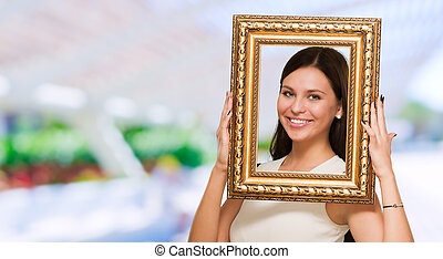 Portrait Of A Young Girl Holding Frame