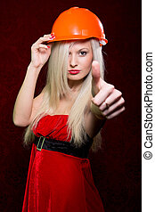 Portrait of a young girl in a Santa suit and helmet of the build
