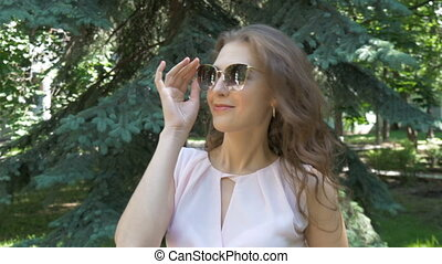 Portrait of a young girl in sunglasses, slow motion