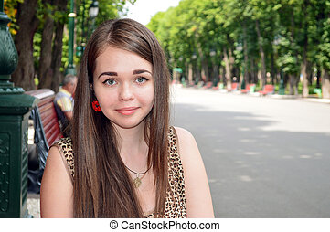 Portrait of a young girl in the park
