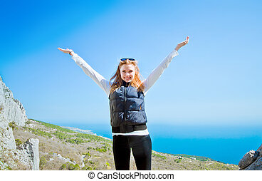 portrait of a young girl on a hill overlooking enjoying with the