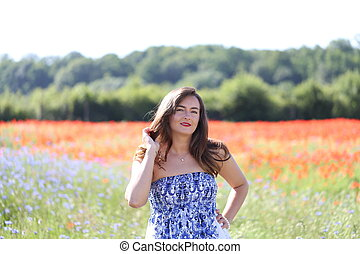Portrait of a young girl on cornflower blue field