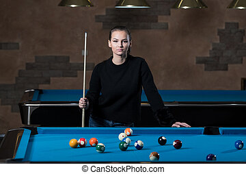 Portrait Of A Young Girl Playing Billiards