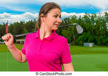 Portrait of a young girl playing golf