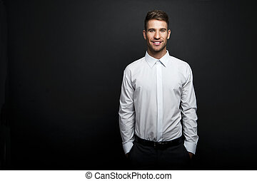 Portrait of a young handsome man a white shirt