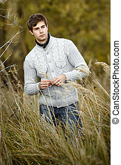 portrait of a young handsome man in a sweater