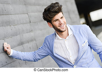 Portrait of a young handsome man, model of fashion, smiling...