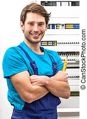 Portrait of a young handyman with multimeter