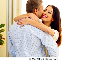 Portrait of a young happy couple hugging