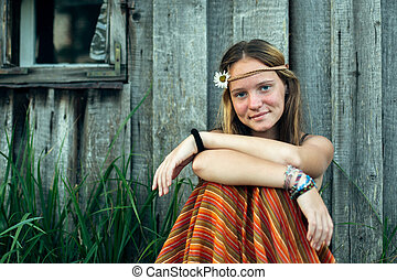 Portrait of a young hippie girl, in the village.