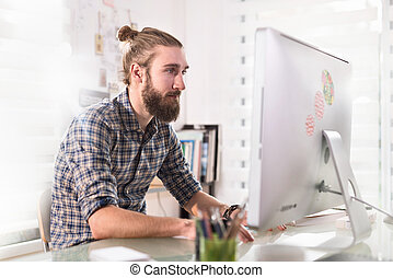 portrait of a young hipster working on a computer