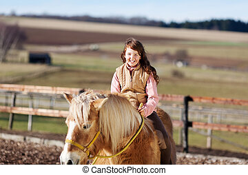 Portrait of a young horse rider girl