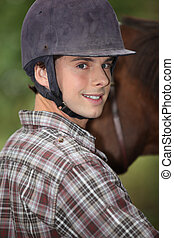 Portrait of a young horseback rider