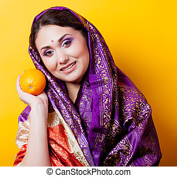 Portrait of a young indian girl in sari with orange