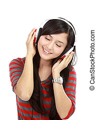 Portrait of a young lady with earphones listening music to...