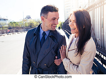 Portrait of a young laughing couple outdoors