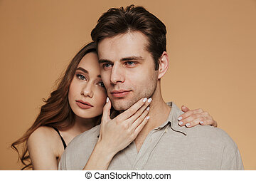 Portrait of a young loving couple hugging