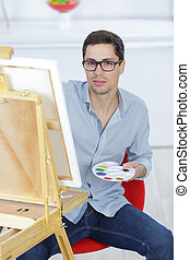 portrait of a young male artist at work
