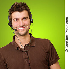 Portrait Of A Young Male With Microphone Isolated On Green...