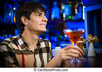 portrait of a young man at the bar