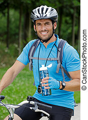 portrait of a young man biking