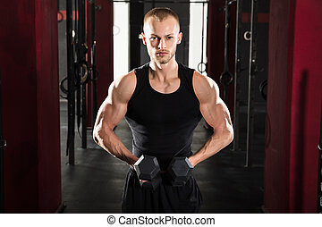 Man Exercising With Dumbbell