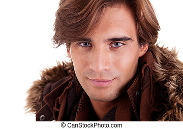 Portrait of a young man, in autumn/winter clothes, isolated on white. Studio shot