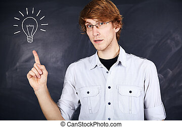Portrait of a young man - pensive young man with glasses...