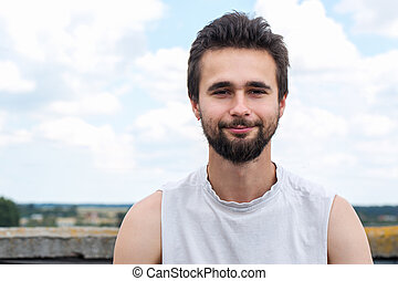 Portrait of a young man with a beard close-up
