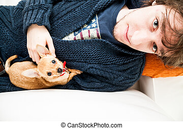 portrait of a young man with a Chihuahua