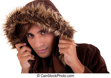 Portrait of a young man with a furry hood , in autumn/winter clothes, isolated on white. Studio shot