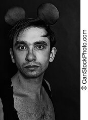 man with a sham mouse ears