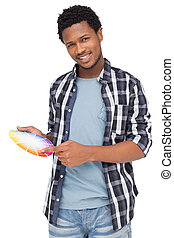 Portrait of a young man with paint samples