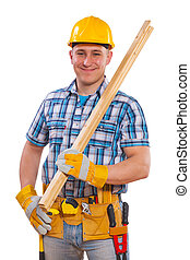 portrait of a young men with carpentry tools and planks
