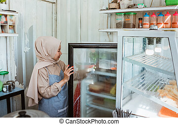 portrait of a young Muslim woman take something