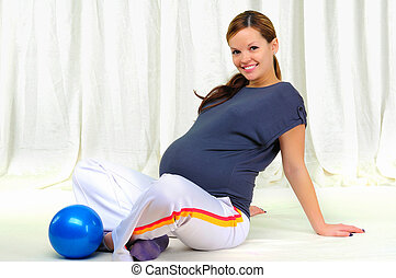 Portrait of a young pregnant girl