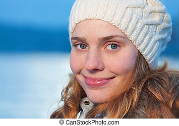 Portrait of a young pretty woman at winter