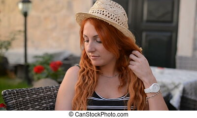Portrait of a young red-haired European woman