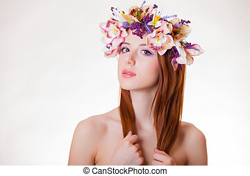 portrait of a young redhead girl with flower wreath