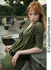 Portrait of a young redhead woman