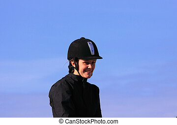 portrait of a young rider before a contest