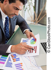 Portrait of a young sales person studying statistics