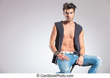 young sexy fashion man sitting on a stool