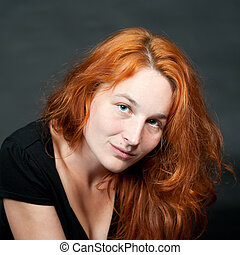Portrait of a young sexy redhead woman