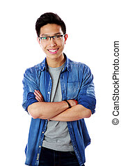 Portrait of a young smiling asian man with arms folded over white background