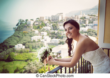 Portrait of a young smiling bride