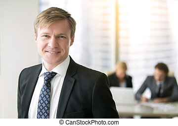 Portrait of a young smiling businessman - Portrait of young...